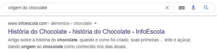 """Exemplo de meta description em pesquisa pela palavra-chave """"origem do chocolate""""."""